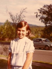 Bec rocking a drop-waist dress and a red hairband when she was eleven in 1983.