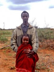 10-year-old Tume stands with her 22-year-old husband. He does not allow her to go to school, and she will likely soon be pregnant - sentencing her and her children to a lifetime of poverty.