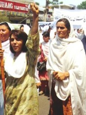 Afghan woman's rights activists march in Pakistan.