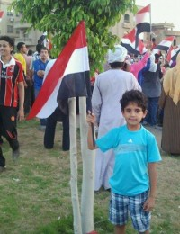 small boy holding egyptian flag