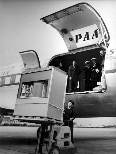 5 megabyte IBM hard disk being loaded into a plain (1965)