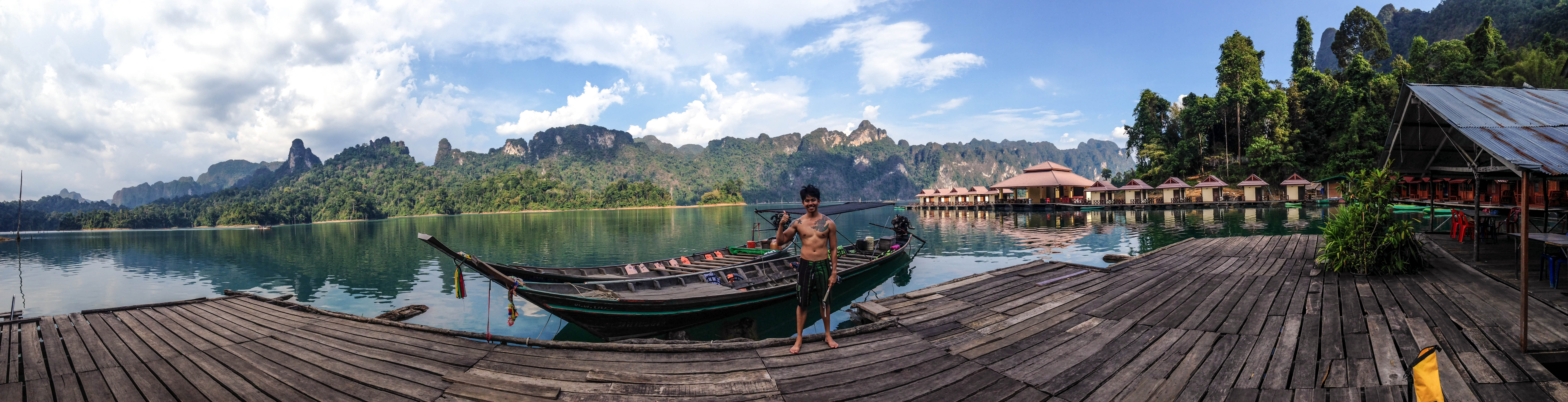 boy standing in front of raft houses.