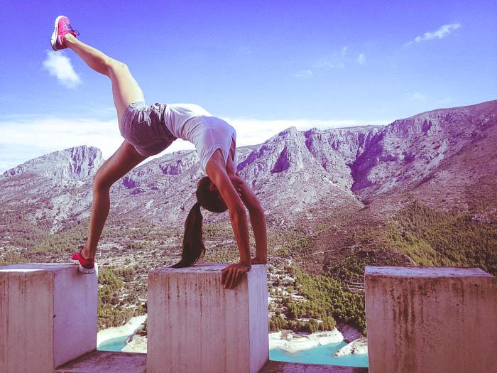 girl doing yoga at guadalest castle