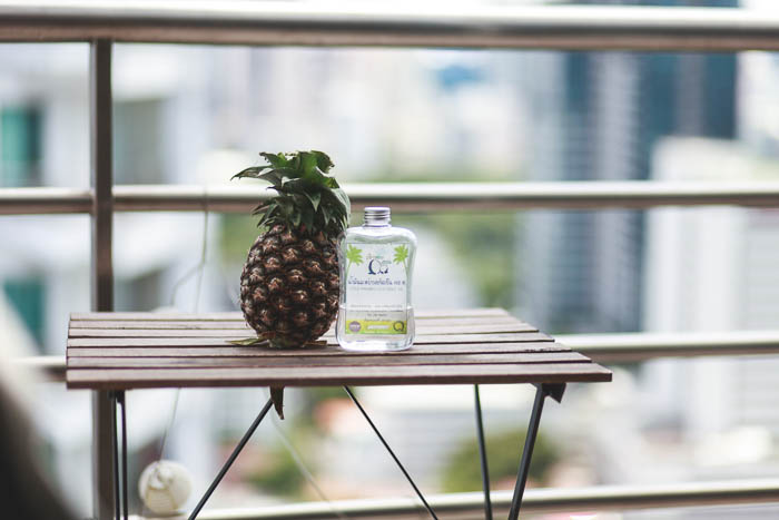pineapple and coconut oil on balcony table