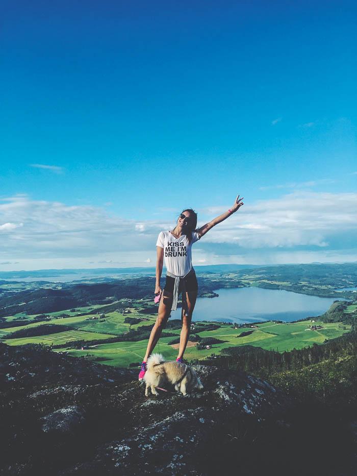 girl trekking in stokkvola norway wearing nike walking a dog