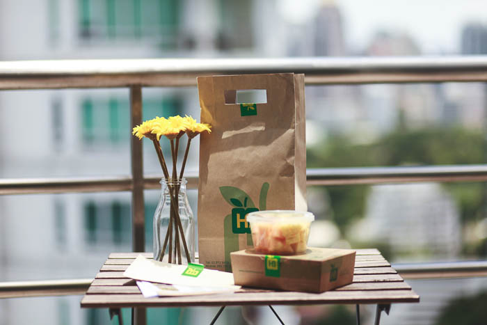 meal from healthbox and snack box on table next to sunflowers