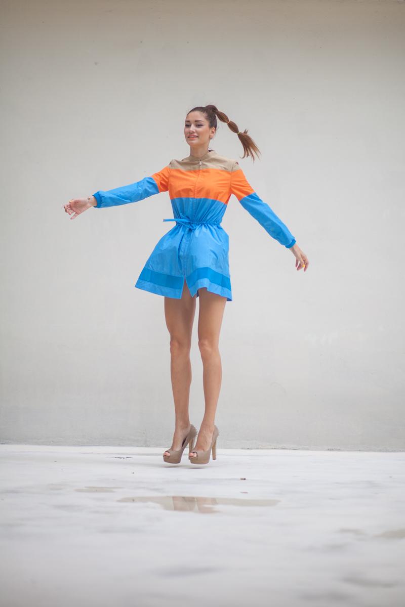 girl jumping wearing a colourblock dress