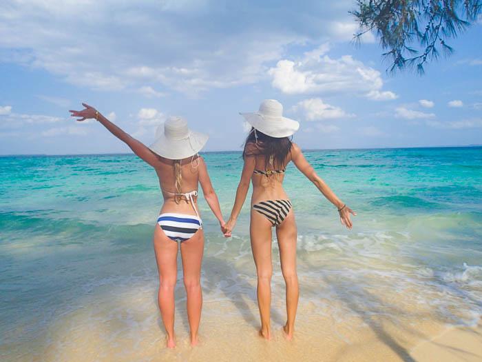 two girsl on beach wearing bikini