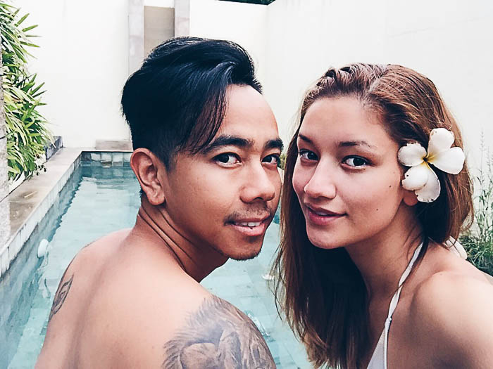 couple selfie pool villa