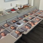 Mug shots of the 23 arrested, laid out on a table at Manchester Police headquarters.
