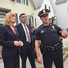 Gov. Maggie Hassan, left, and U.S. Drug Czar Michael Botticelli get the facts on Manchester's heroin crisis from Manchester Police Sgt. Brandon Murphy.