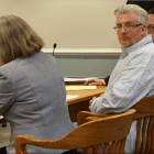 Eric Largy, center, is pictured with his public defenders, Suzanne Ketteridge, left, and Michael Davidow, on Friday in Hillsborough County Superior Court South in Nashua.