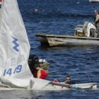 Winds broke the mast of a sailboat on Lake Massabesic, causing two boats to capsize.