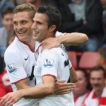 Nemanja Vidic and Robin van Persie celebrate