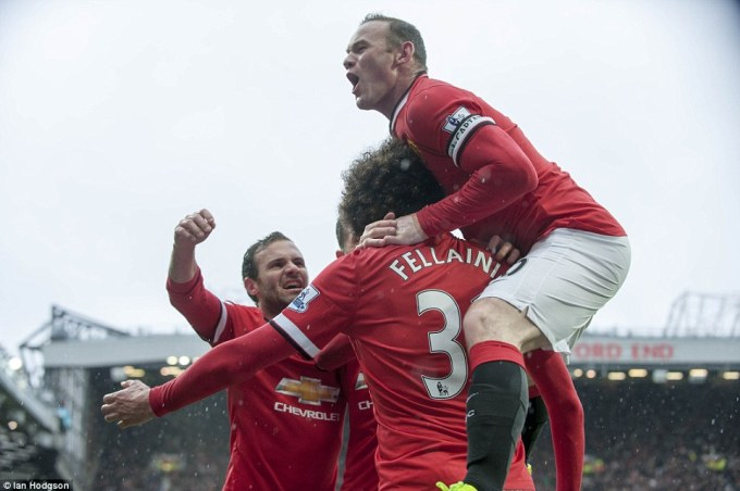 277E29FC00000578-3035938-Wayne_Rooney_leaps_onto_the_big_Belgian_s_back_after_United_take-a-60_1428859445069