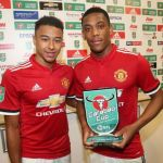 MANCHESTER, ENGLAND - SEPTEMBER 20:  Jesse Lingard presents Anthony Martial of Manchester United with the Man of the Match award after the Carabao Cup Third Round match between Manchester United and Burton Albion at Old Trafford on September 20, 2017 in Manchester, England.  (Photo by John Peters/Man Utd via Getty Images)