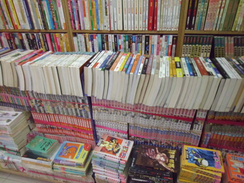 A stack of comic books outside a bookstore