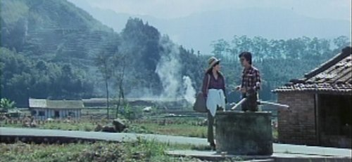 Xiaohui and Jintai in the Taiwanese countryside next to a well.