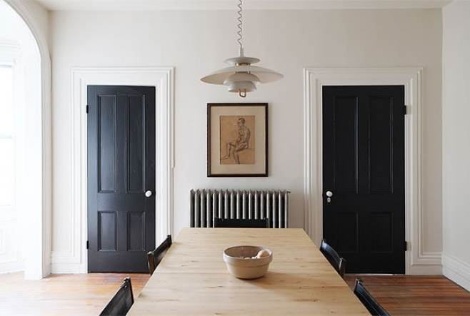 Black interior doors via Manhattan Nest