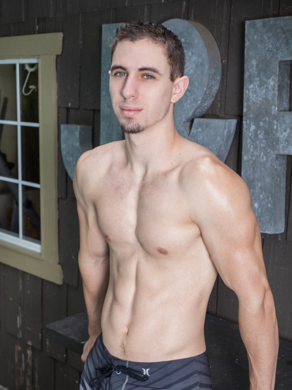 Jake Orion strips down, strokes his big cock and fingers his hairy young ass hole in a solo scene for gay porn site Randy Blue.