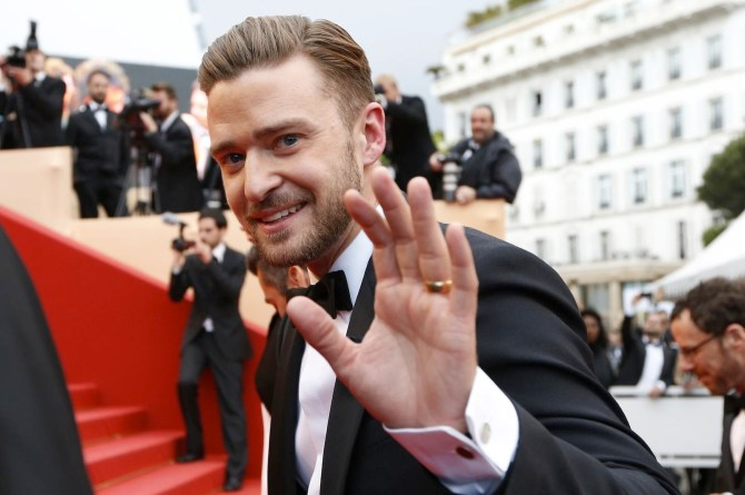 "US actor and singer Justin Timberlake waves on May 19, 2013 as he arrives for the screening of the film ""Inside Llewyn Davis"" presented in Competition at the 66th edition of the Cannes Film Festival in Cannes. Cannes, one of the world's top film festivals, opened on May 15 and will climax on May 26 with awards selected by a jury headed this year by Hollywood legend Steven Spielberg. AFP PHOTO / VALERY HACHE"