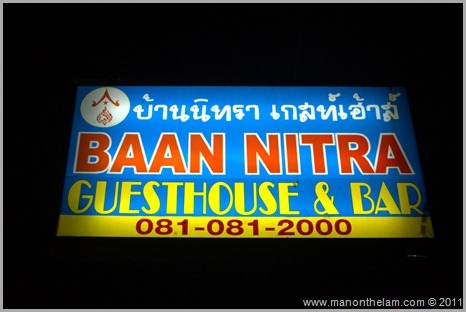 Roomorama Baan Nitra Guesthouse and Bar sign Phuket Thailand