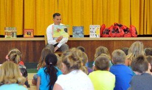 """MU President Fran Hendricks reads """"Ferdinand and the Bullies"""" to the Reading Camp students."""