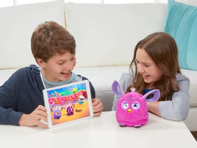 boy and girl playing with furby connect toy and app