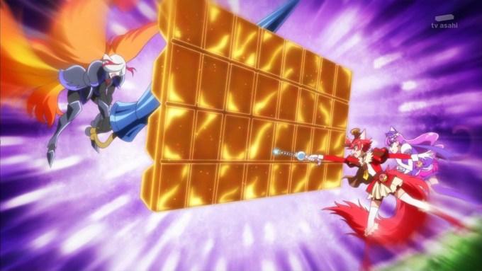 エリシオからの攻撃からキュアマカロンを守るキュアショコラ
