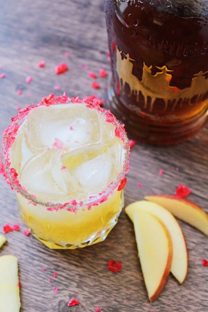 Candy Apple Margarita! Perfect for any hour especially happy hour. Quality tequila, lime juice, orange liqueur, and a homemade apple simple syrup. This drink is perfect and must be made today!