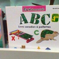 Livre canadien à paillettes