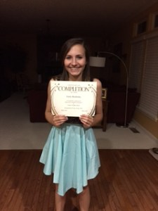 emily holding certificate