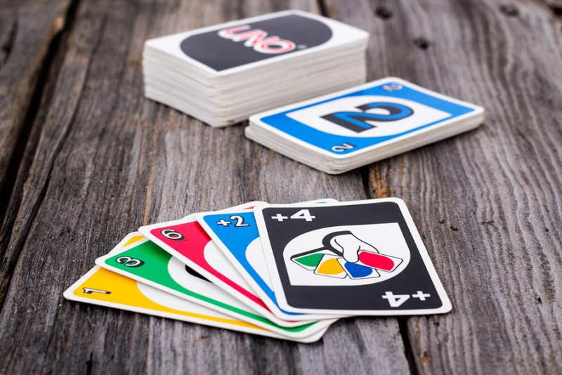 Sorel-Tracy Canada - January 13 2016: view of Uno card game on old wood table. The game was developed by Merle Robbins in Ohio USA in 1971 it is a Mattel product since 1992.