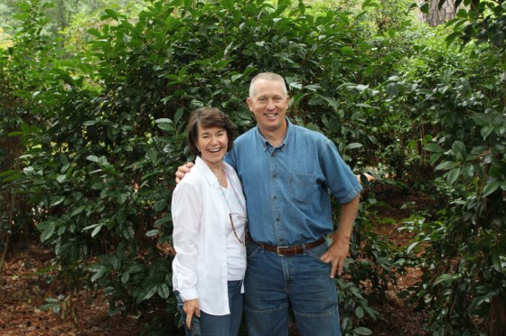 My wife enjoys a hug from noted horticulturist Greg Grant in front of one of the many camelias in the SFA arboretum's collection