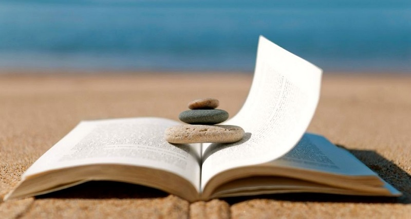 101113-lifestyle-meditation-book-beach-relax-calm-vacation-reading-1050x635