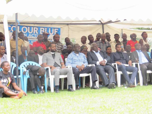 Besigye and other opposition figures at his home.
