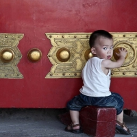 Child playing in Beijing's Forbidden City
