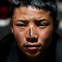 Tibetan boy after the children's blessing