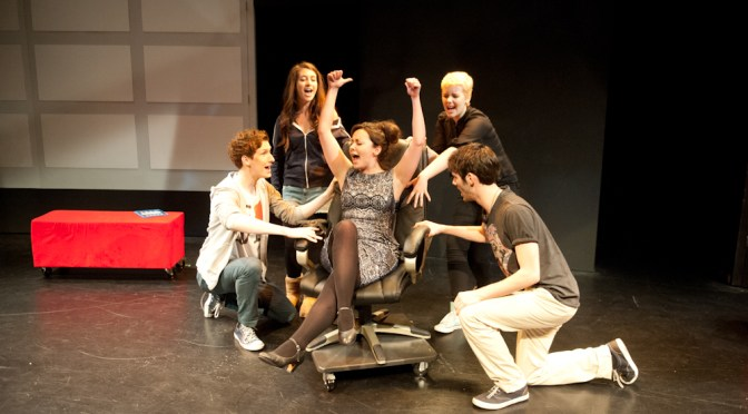 Sarah Earnshaw (centre) and the ensemble of Paybck – The Musical. Photo: Phil O'Connor