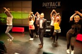 Matthew White (centre) with the ensemble of Payback the Musical. Photo: Phil O'Connor
