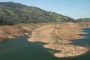 Aerial view of extreme low water (drought) conditions at New Melones Lake. Shot - 2/20-2015.