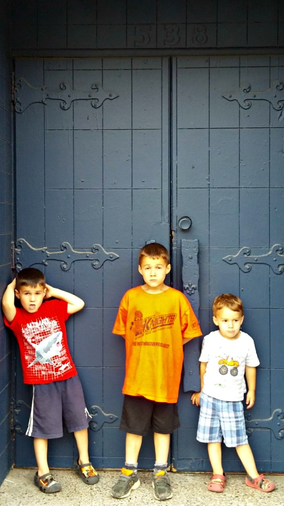 boys against blue door