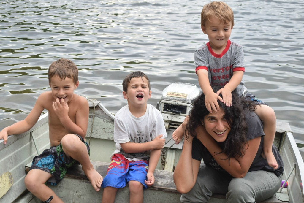 me and the boys on boat at cottage
