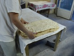 Stacking the finished lavash for sale.