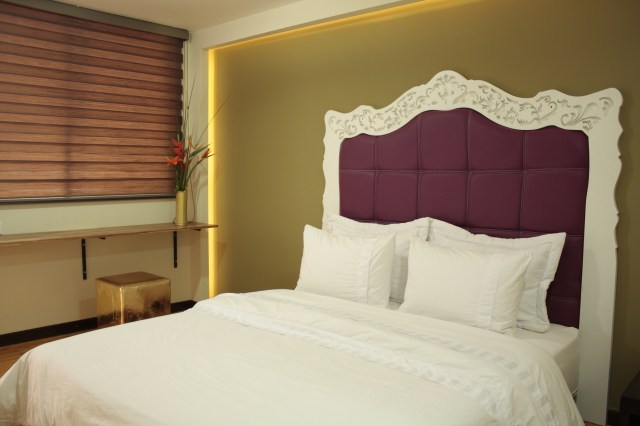 You'll feel like you're in a hostel in one of the private rooms at Happy Buddha Boutique Hostel.