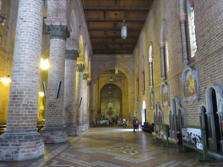The right side aisle with confessionaries along the wall
