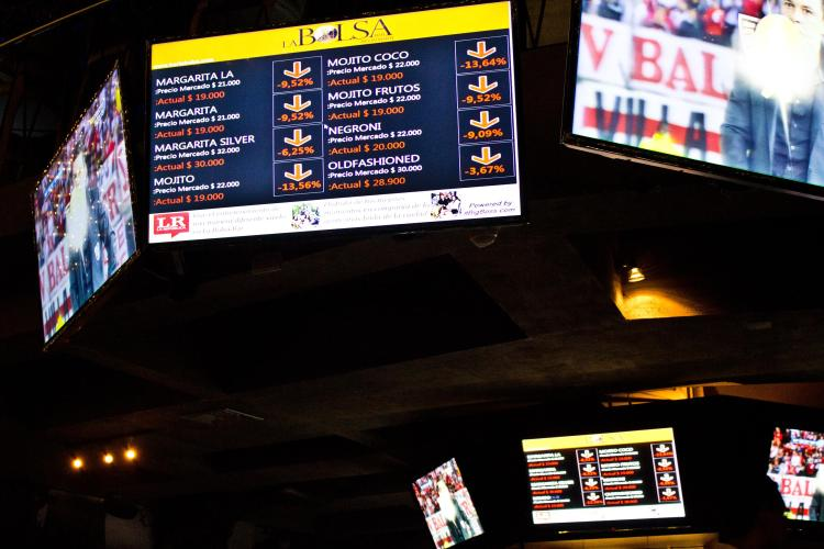 """Screens that showed the """"crashing"""" prices of alcohol at the restaurant that night."""