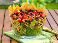 Layered Mexican Salad  Ingredients/Directions:   1 box Betty Crocker® Suddenly Salad® classic pasta salad mix 3 tablespoons water 2 tablespoons vegetable oil 1 teaspoon ground cumin 1 can (15 oz) Progresso® black beans, drained, rinsed 1 can (15.25 oz) Green Giant® whole kernel corn, drained 4 cups torn romaine lettuce 1 container (12 oz) refrigerated guacamole dip 1 1/2 cups finely shredded Mexican 4-cheese blend (6 oz) 3 plum (Roma) tomatoes, chopped 1 can (2 1/4 oz) sliced ri...