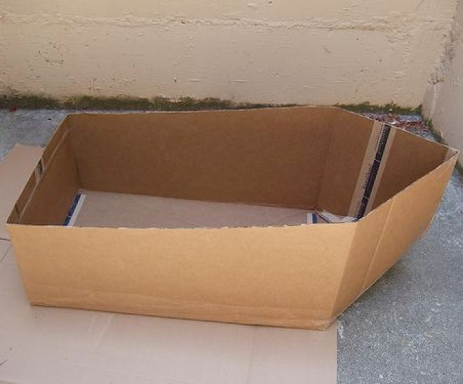 Cardboard boat, which could be secured around waist.
