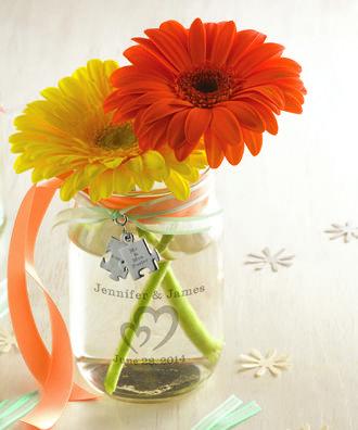 For a fun wedding centerpiece use personalized mason jars